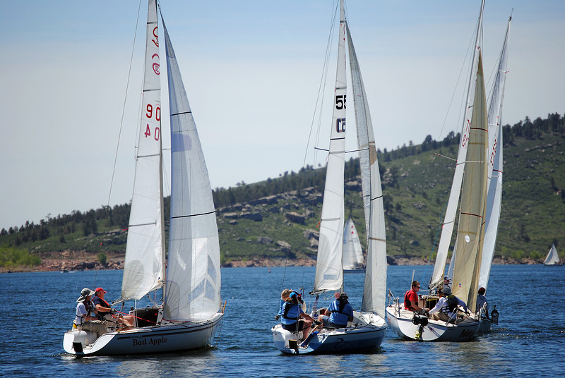 Sailboats make their way around the course in Carter Lake during the 54th annual Carter Lake Sailing Open Regatta on Sunday June 2, 2013. The race consisted of 27 boats with races from all over the sate that where divided into six different classes.