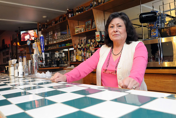Mercy Rivera stands Friday behind the counter at Leo's Place Bar and Grill in downtown Johnstown which she has owned for 20 years. Rivera's business is one of many whose address has been pilfered for locksmith listings online and in the local telephone book.