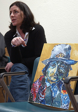 Citizens First committee organizer Dorian Tacy explains the importance of the painting of Sitting Bull, by Quinn Reed, next to her Mar 6.  The piece is one many that have been donated to the group as part of their upcoming Art in the Garden fundraiser.