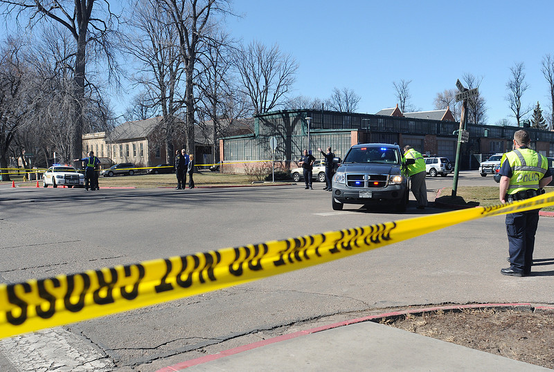 Law enforcement personnel work the scene of a fatal train versus pedestrian accident at Old Main Drive and Mason Street on the Colorado State University campus in Fort Collins on Friday, March 12, 2010.