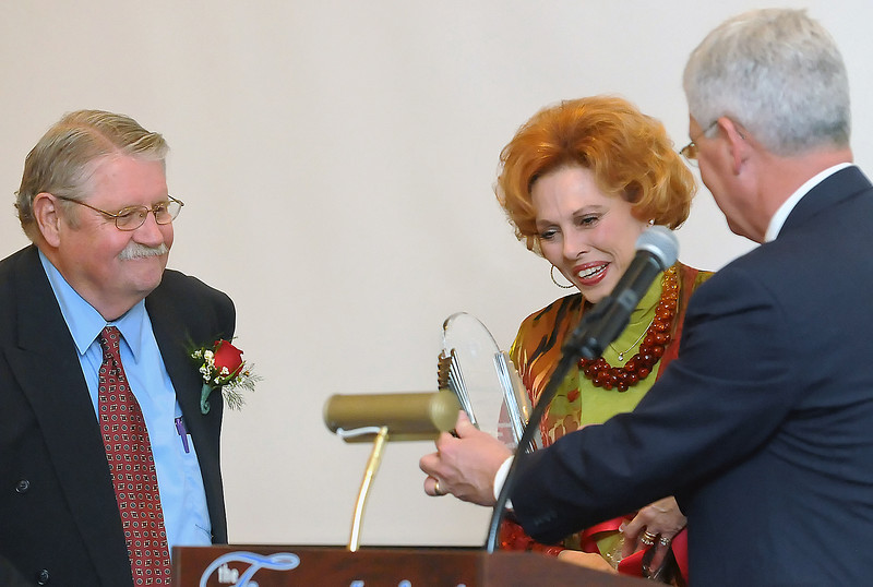 Bill Kaufman, right, presents Ron and Sharon Sheets with the Loveland Distinguished Citizen Award during a dinner in their honor on Tuesday, March 30, 2010 at the Fountains of Loveland.