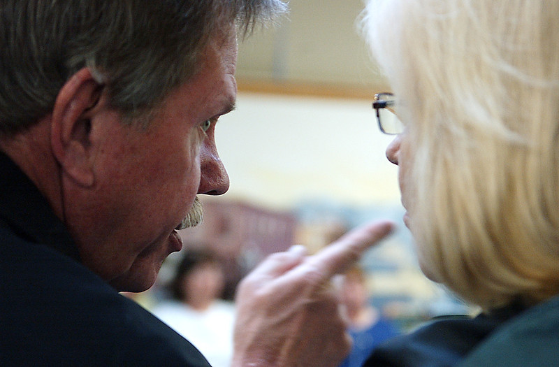 John and Marilyn Titus discuss something in private during the Berthoud meeting of Citizens First, Mar 6.