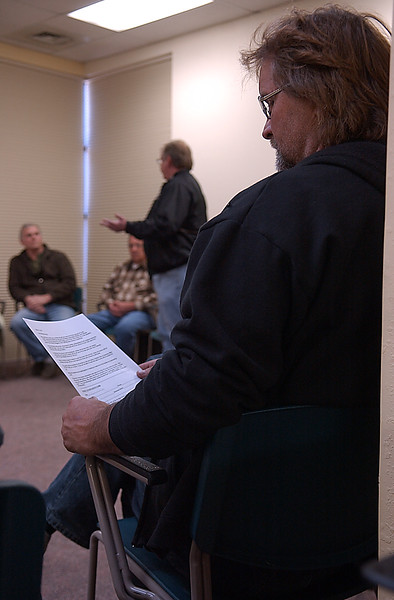 David Norrie scans the Berthoud meeting of Citizens First, Mar 6, While trustee Dick Shepard address the room.