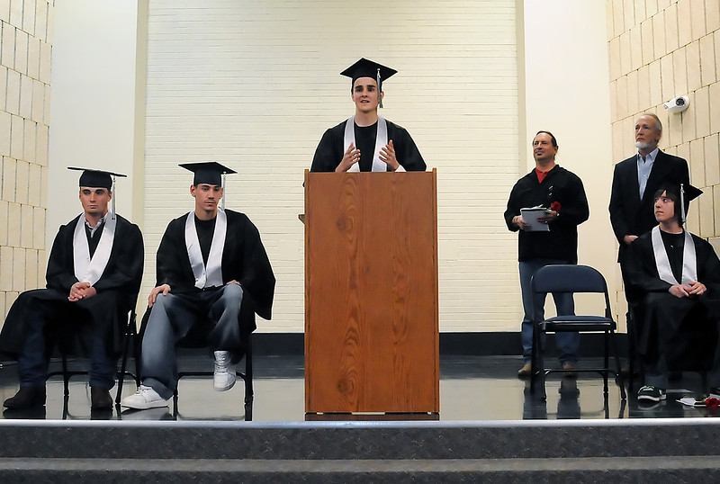 Ferguson High School's Jack Ross, center, speaks during the school's third quarter graduation ceremony on Thursday, March 11, 2010. Front from left are Taylor Zweigle, Kobi Vargas, Ross and Neil Dechant and at rear from left are teachers Bill Seideman and Chris Carstensen.