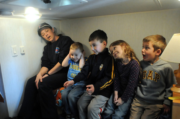 Youngsters react as a smoke detector goes off in the bedroom of the Fire Safety House trailer as they learn about fire dangers as part of the Colorado Children's Day events in downtown Loveland on Wednesday, March 3, 2010. From left are volunteer firefighter Gina Gonzales, Joshua Pankau, 3, Jack Broccoli, 6, Alyssa MacDonald, 5, and Cole Broccoli, 4.