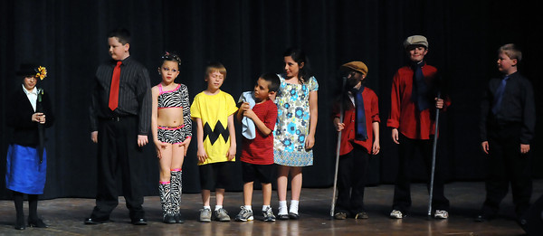 Contensants from the elementary school division of the 49th Annual Stars of Tomorrow Show prepare to take a final bow together at the conclusion of their individual performances. From left are Gabrielle Wells, David Konicek, Hunter Thomas, Nick Windisch, Gavin Pollyea, Anne Pollyea, Anna Mihaly, Aiden Mihaly and Adam Konicek.