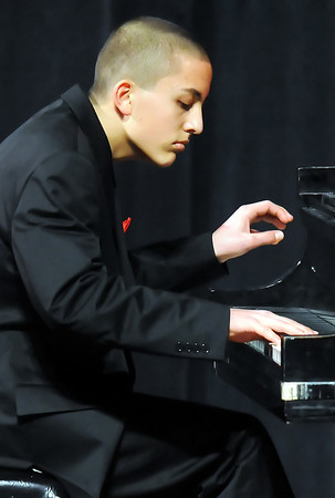 Daniel Greenidge, 14, performs on the piano during the middle school division of the 49th Annual Stars of Tomorrow Show on Saturday at Roberta L. Price Auditorium at Thompson Valley High School.