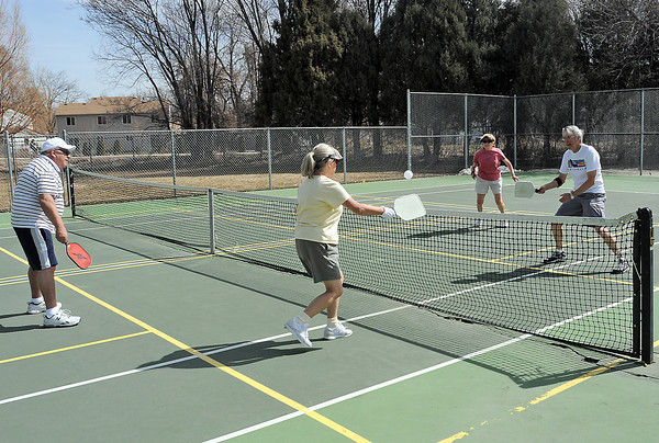 "A group of Lovelanders plays pickleball Tuesday afternoon on the court at Sunnyside Park. From left are Larry McGee, Sue Erickson, June Fletcher and John Erickson. Visit  <a href=""http://www.usapa.org"">http://www.usapa.org</a> for information on pickleball or email lovelandpickleball@gmail.com for info about playing the game in Loveland."
