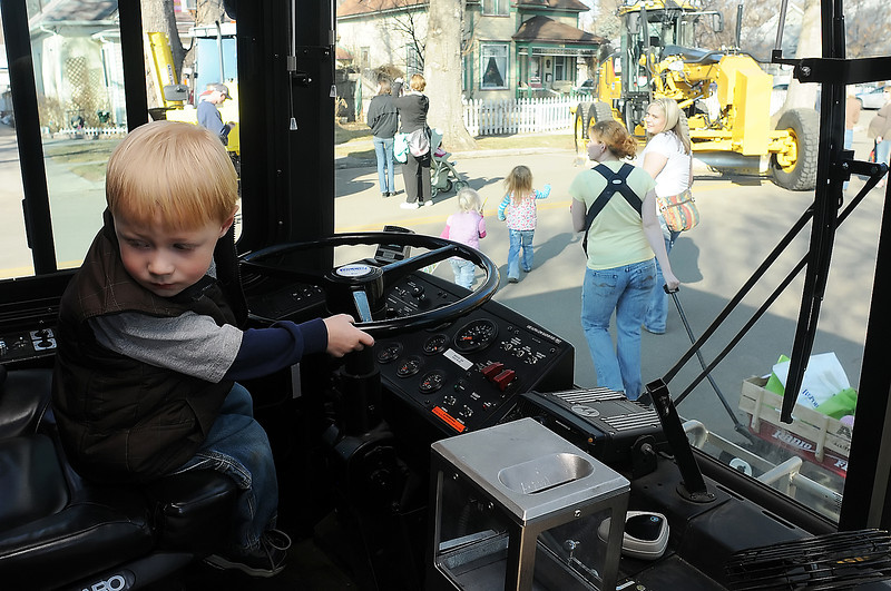 Three-year-old Sam Topham looks around while pretending to drive one of the City of Loveland's busses during the Colorado Children's Day events in downtown Loveland on Wednesday, March 3, 2010. The Touch-a-Truck event included a variety of different trucks and other equipment that the participants could explore and ask questions about.