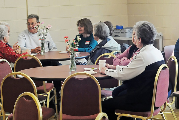 Loveland Community Kitchen volunteers enjoy a free lunch Thursday at the facility's new location at 437 N. Garfield Ave. as a preview to the opening on Monday.