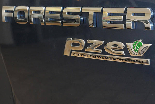 The rear badge on a 2010 Subaru Forester with the Partial Zero Emission Vehicle classification available at Davidson-Gebhardt Auto Group, 3883 Test Circle in Loveland.