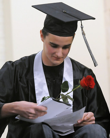 Ferguson High School student Jack Ross sits onstage in his cap and gown during the school's third quarter graduation ceremony on Thursday, March 11, 2010.