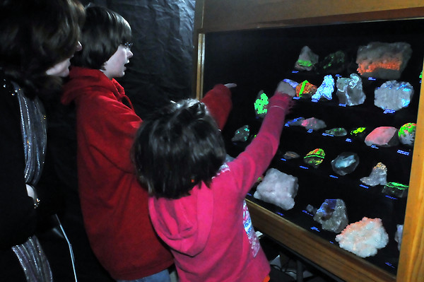 Janice Clack, left, and her children, Jordan, 12, and Nicole, 8, look at a display case filled with fluorescent minerals during the Fort Collins Rockhounds' 50th Annual Gem and Mineral Show on Saturday at The Ranch. The show continues today from 10 a.m. to 5 p.m. and features a variety of exhibits, demonstrations and vendors as well as door prizes and silent auctions. Admission is $4 for adults, $1 for students 12-18 years old and children under 12 are admitted free when accompanied by an adult.