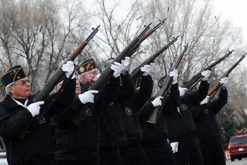 Members of the Associated Veterans of Loveland Honor Guard fire rifles loaded with blanks during a 21-gun salute Wednesday outside Loveland Veterans of Foreign Wars Post 41 in downtown Loveland during a ceremony honoring veterans who served in the Vietnam War.