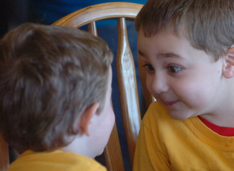 Payton Deming, 4, left, and Connor Barron, 5, have a staring contest while eating greene eggs and ham.