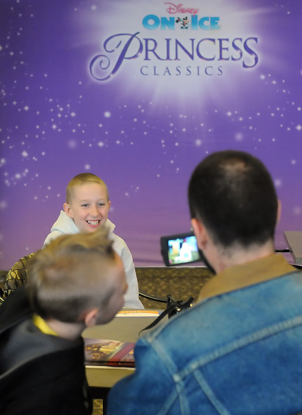Ten-year-old Daphne Phelps, 10, of Longmont is videotaped by her dad, Ken, while her brother Cedric, 8, looks on at the Budweiser Events Center on Thursday after watching a practice session and meeting one of the performers. In addition to watching practice Daphne and her family were treated to dinner and later returned to watch the opening-night performance of the show as part of a Make-A-Wish Foundation grant.
