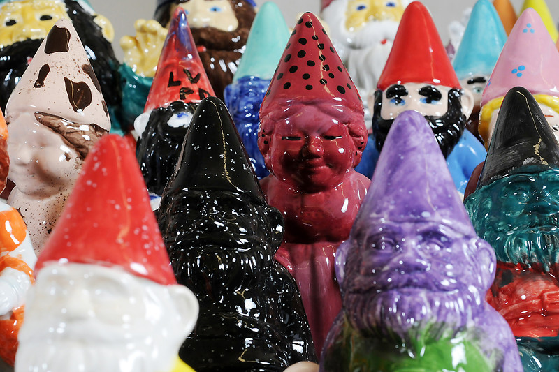 Ceramic gnomes decorated by Loveland Police Department Explorers and other members of the department for a fundraising effort are displayed on a table at the department last January.