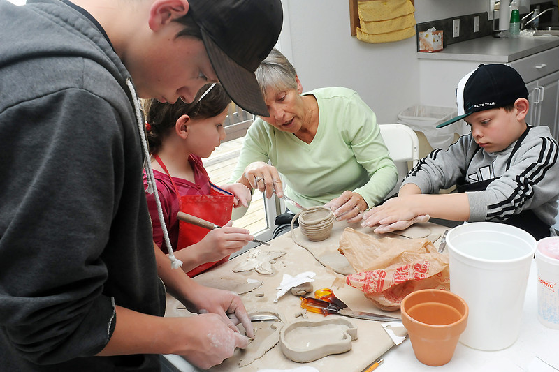 "Carol Maxfield, third from left, make items out of clay with her grandchildren during the Third Thursday Craft Class on Thursday afternoon at the Timberland Farm Museum, 2306 E. First St. From left are Drew Van Winkle, 14, Corinne Van Winkle, 7, Maxfield, and Darren Van Winkle, 10. Visit  <a href=""http://www.timberlanefarmmuseum.org"">http://www.timberlanefarmmuseum.org</a> for more informaiton on upcoming events at the museum."