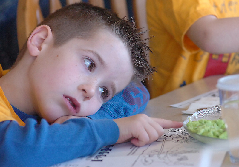 Cyrus Carlson, 5, uses his index finger to push his plate of green eggs and ham away from him Wednesday as he and classmates from Trinity Lutheran Preschool eat at The Egg & I in Loveland.