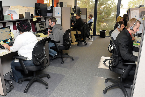 Employees in Madwire Media's project management division work at their computers Wednesday at the company's location on the south side of Lake Loveland at 504 W. Eisenhower Blvd.