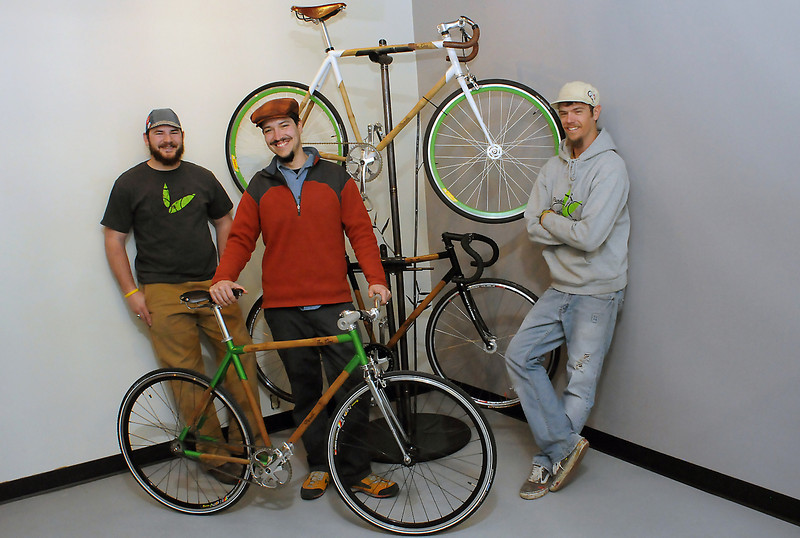 Panda Bicycles sales manager Josh Stratton, left, co-founder Jacob Castillo and frame builder Kameron Moore pose next to several models of the company's bamboo-framed bicycles last week in the showroom area of the Fort Collins business located at 130 W. Olive St., Unit E.