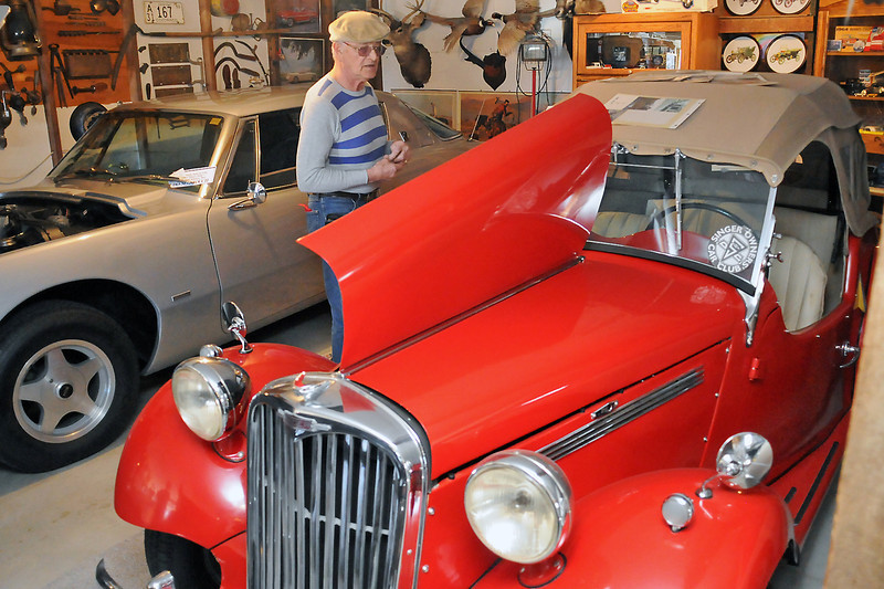 Rick Haskell stands inbetween his 1953 Singer 4AD Roadster, at right, and 1963 Studebaker Avanti as he talks about his car collection last Tuesday, March 1, 2011 inside the barn he uses to store some of his vehicles.