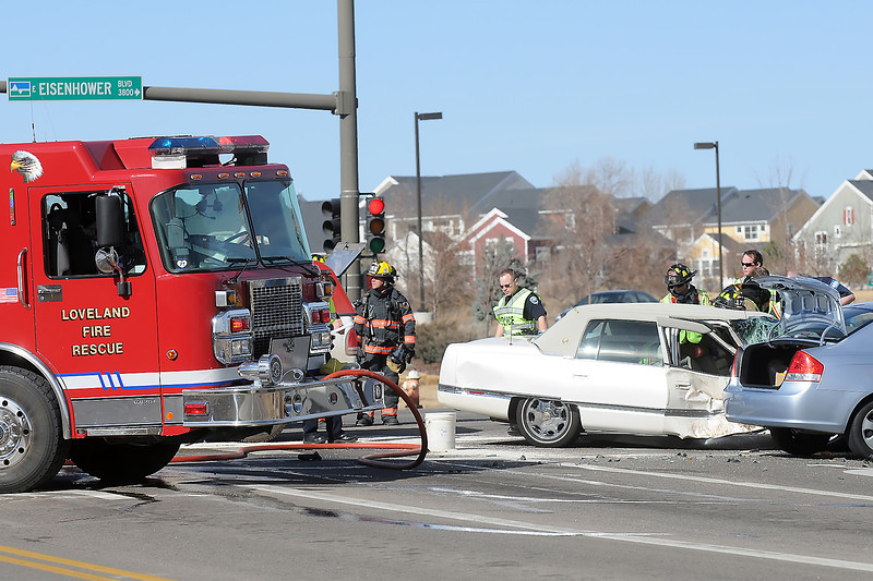 Emergency personnel work the scene of an automobile accident Friday afternoon at the intersection of Eisenhower Boulevard and Boyd Lake Avenue.