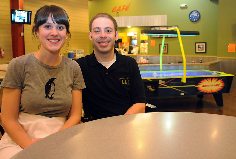 Julie and Jeff Willy pose together in the Loveland Laser Tag Fun Center business that they recently purchased. In addition to laser tag the facility also offers a cafe and dining area, video games, basketball, foosball, air hockey,
