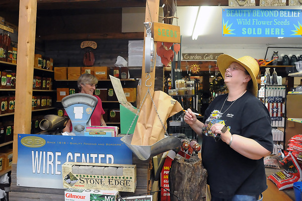 Loveland resident E.J. Schneider, right, shares a laugh with Lynn Lucas while weighing some potatoes and purchasing seeds Friday afternoon at Gateway Garden and Home Center, 530 Garfield Ave. Schneider had a chart with the various plants for her garden all mapped out and said she would start planting today. Hours at the garden center are 8 a.m. to 6 p.m. Monday to Saturday and beginning April 10 through the summer they're open Sundays from 10 a.m. to 4 p.m.