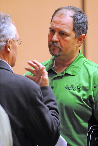 Windsor developer Martin Lind, right, chats with Tony Fiest of Denver during a real estate auction conducted by J.P. King auctioneers Thursday at the Embassy Suites Hotel and Conference Center in Loveland.