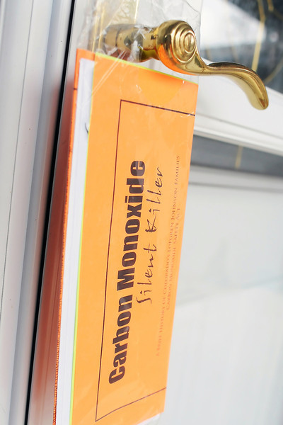 A packet containing information on carbon monoxide poisoning hangs from a handle on the front door of a home in Windsor after volunteers from the Lauren Project made a visit March 5, 2011 during their door-to-door campaign to educate residents about the dangers of carbon monoxide.