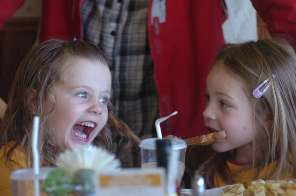 Sydney Sandridge, 5, left, and Addi Pierce, 4, act silly during breakfast.