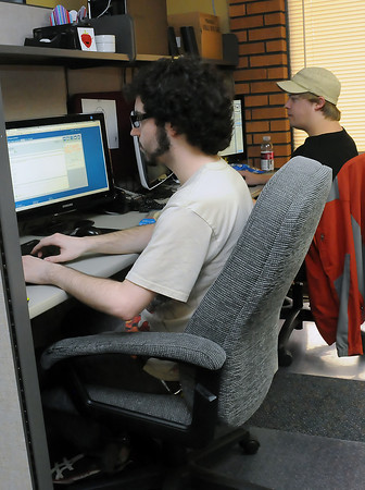 Madwire Media web designers Joshua Rice, left, and Eric Veum work on pages Wednesday afternoon at the Loveland business.