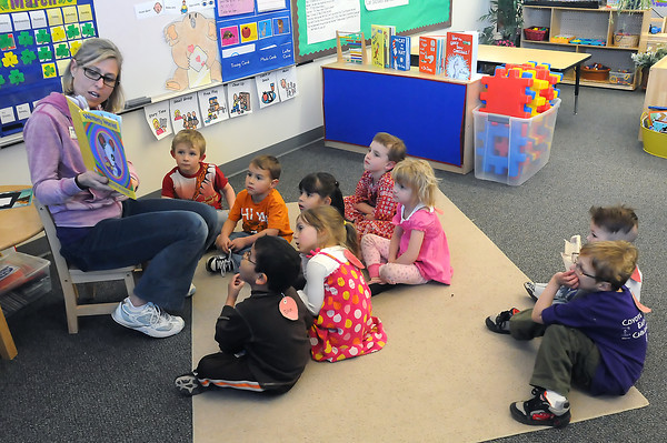 Early childhood special educator Karin Miller reads a book to preschoolers in her class during story time Tuesday afternoon at Coyote Ridge Elementary School.