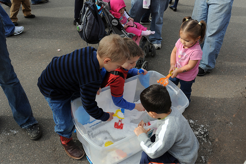 Youngsters play with fake snow during Colorado Children's Day activities in downtown Loveland on March 2, 2011. From left to right are Colton Zack, 4, Cyrus Carlson, 5, Kyler Glaze, 4, and Dakota Ornelas-Moore, 2.