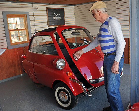 Rick Haskell opens the front door of his 1959 BMW Icetta last Tuesday, March 1, 2011 while discussing the variety of cars he currently owns and has collected over the years.