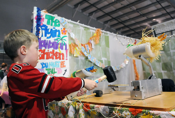 "Loveland resident Rylan Pyy, 5, launches a rubber chicken at the Bits 'N' Pieces 4-H Clubs game called ""The Flyin' Hawaiian Chicken"" on March 19, 2011 during the annual 4-H Carnival at The Ranch."