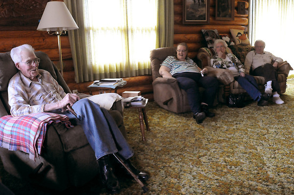 Barnham J. Nash shares a laugh in his Masonville home Friday with relatives Judy Heinrichs, Verna Nash and Ray Nash, who are in town to celebrate Barnham his 100th birthday on Sunday, March 6.