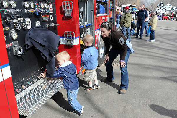 Troy Wingard, 2, left, and his brother, Jack, 4, check out a firetruck while participating in Colorado Children's Day with their mother, Esther, in downtown Loveland on March 2, 2011.
