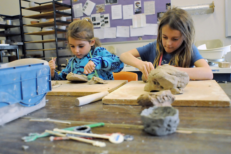 Sarah Johnson, 7, right, and her sister, Molly Johnson, 5, make creations out of clay in the Chilson Recreation Center's wet crafts room during an activity as part of Colorado Children's Day on March 2, 2011.