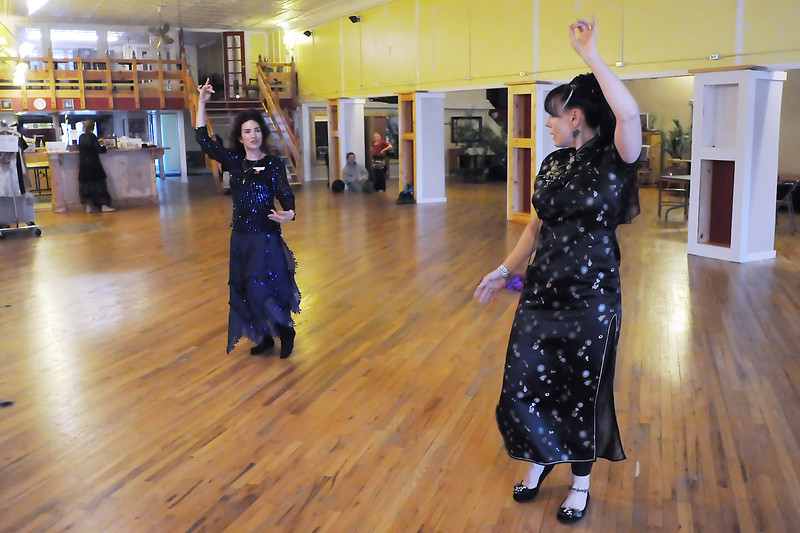 Cherry Blossom's Belly Belles dancers Janet Schreiner, right, and Sandra Lull practice a dance together Wednesday a Cherry Blossom in downtown Loveland.