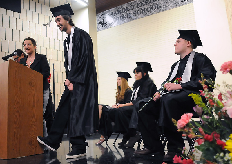 Ryan Brady, center, laughs during Ferguson High School's third quarter graduation ceremony Friday at the school. From left are teachers Bill Seideman and Cathy Beach, and Ferguson graduates Brady, Brittany Ledwell, Alyssa Cochran and Jesse Behnke.