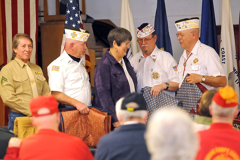 Quilt maker Sonje Jessen, center, stands with several members of the Loveland Vetarans of Foreign Wars Post 41 after giving them quilts during a ceremony Wednesday in honor veterans who served during the Vietnam War. Back from left to right are Paul Abeyta, Ted Gilbert, Jessen, Steve Rylant and Harry Weber.