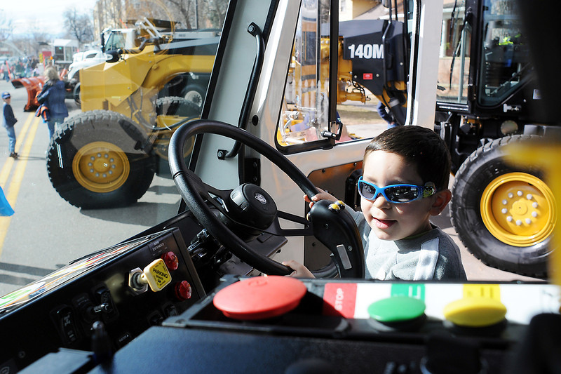 Four-year-old Elijah Campos of Loveland sits behind the wheel of a recycling truck while taking part in Colorado Children's Day activities in downtown Loveland on March 2, 2011.