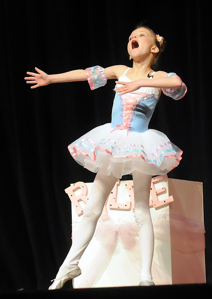 "Rylee Vogel, 9, sings and dances to the song ""I've Got No Strings"" from Walt Disney's Pinocchio during Stars of Tomorrow on Saturday, March 12, 2011 at Thompson Valley High School's Roberta L. Price Auditorium."