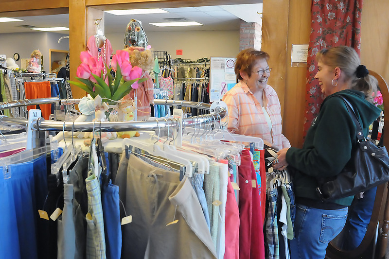 Johnstown resident Mindi Nazarenus, right, and Sandy Holtz of Milliken share a laugh while looking through the clothing on display at McKee Thrift Avenue in downtown Loveland at 428 N. Cleveland Ave. on Saturday during the store's Thrif-Tea Spring Re-Opening. Each spring and fall the store takes out the previous season's clothing lines and replaces it with new items. More than 50 volunteers help out at the store throughout the year where donated items are sold to benefit McKee Medical Center programs.