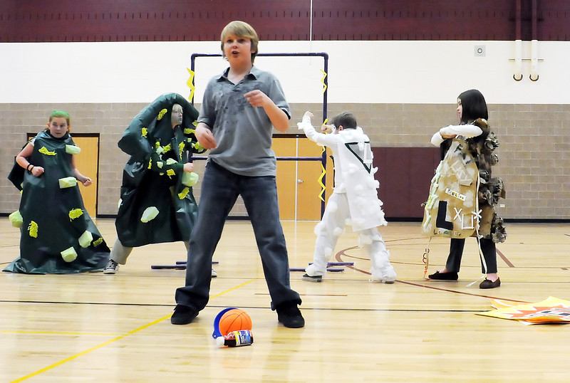 Truscott Elementary School student Kaelan Ramirez, 11, front, and teammembers, back from left, Izze Johnson, 11, Emme Janssen, 10, Colton Attrell, 11, and Maya Bontrager, 10, perform a skit together while competing in the Colorado Odyssey of the Mind, Longs Peak Regional Tournament at Berthoud High School.