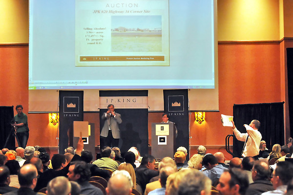 Employees from the auction house J.P. King conduct an auction Thursday afternoon at the Embassy Suites Hotel and Conference Center in Loveland where nearly 600 people converged for the sale of properties in Windsor developer Martin Lind's portfolio of real estate.
