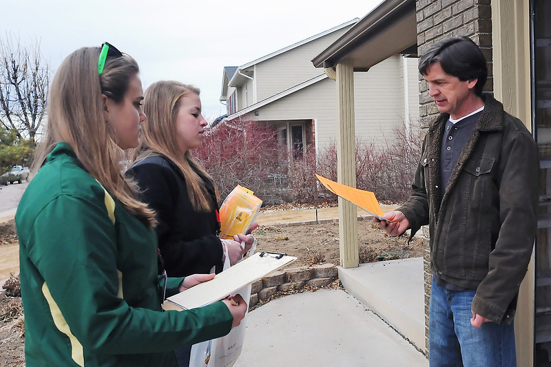 Alicia Kaempfe, left, and Sarah Stringer talk to Alec McGinn outside his home in Windsor during a door-to-door campaign Saturday by the Loren Project to educate and inform residents of Windsor and Severance about the dangers of carbon monoxide. Kampfe and Stringer attend Colorado State University and belong to the Kappa Delta sorority which had 25 members volunteer that day along with five members of the sorority Pi Beta Phi and others.