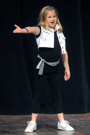 "Madeline Madere, 9, sings ""Real Gone"" during Stars of Tomorrow on Saturday, March 12, 2011 at Thompson Valley High School's Roberta L. Price Auditorium."